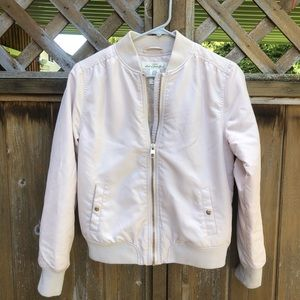 Blush bomber jacket with rose gold accents